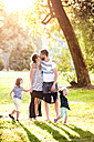 Happy family in a park - HAPF000582