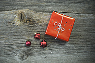Christmas decoration and red present on wood - ASF005922