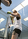 Young woman in gym doing boxing training - MGOF002012