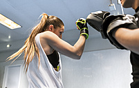 Young woman in gym doing boxing training - MGOF002015