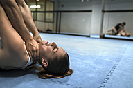 Young woman in gym doing self defense training - MGOF002024