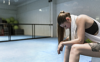 Young woman sitting in gym after workout - MGOF002033