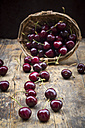 Wickerbasket of cherries on wood - LVF005060
