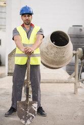 Construction worker next to the concrete mixer - JASF000873