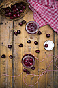 Two glasses of homemade cherry groats and cherries on wood - LVF005065