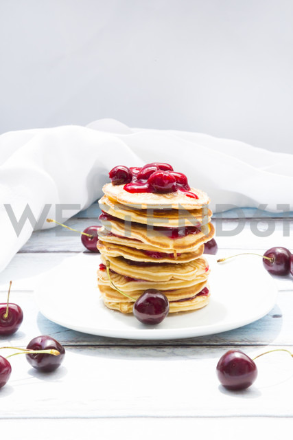 Stack of American pancakes with cherries and cherry groats - LVF005074