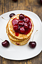 Stack of American pancakes with cherries and cherry groats - LVF005077