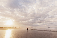 New Zealand, North Island, Bay of Plenty, Ohope Beach, man watching ocean waves, South Pacific Ocean - GWF004772
