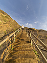 Portugal, Senior man climbing stairs, rear view - LAF001685