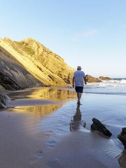 Portugal, Senior man taking a stroll at the beach - LAF001688