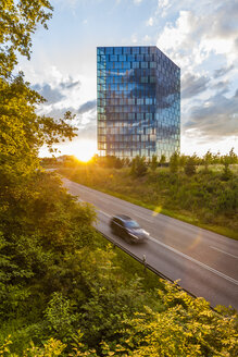 Germany, Stuttgart, view to modern office building with reflection of clouds on glass facade - WDF003686