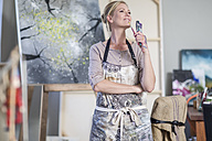 Female painter with paintbrushes in her hand - ZEF008894