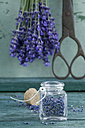Glass of dried lavender blossoms - ASF005932