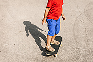 Little boy standing on skateboard, partial view - VABF000667