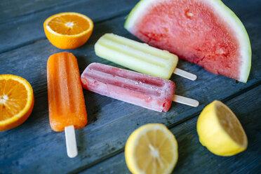 Orange, lemon and watermelon snow ice cream on blue wood - KIJF000516