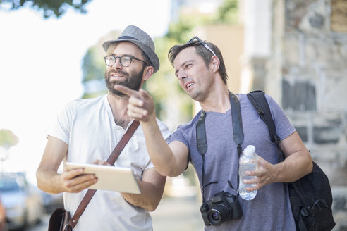 Two men with digital tablet outdoors - ZEF008971