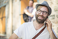 Bearded man talking on cell phone - ZEF008977