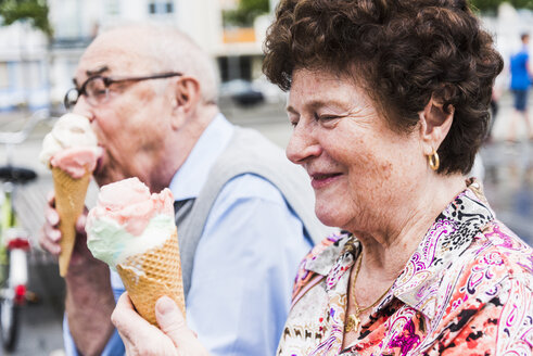 Smiling senior woman with ice cream cone - UUF008052