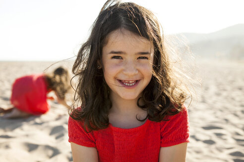 Portrait of happy little girl on the beach - VABF000674
