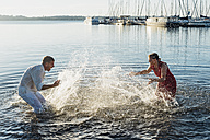Couple squirting each other with water - MJF001983