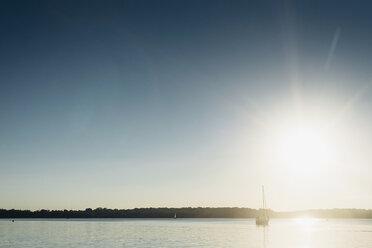 Sailing boat on Lake Cospuden at sunset - MJF001992