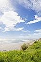 New Zealand, North Island, East Cape region, Mahia Peninsula, person walking along beach, coastline, South Pacific - GWF004820