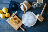 Ingredients to make lemonade on blue wood - KIJF000581
