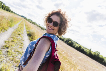 Portrait of smiling young woman in nature - UUF008133