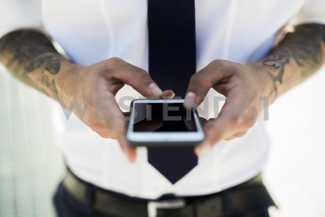 Man's hands text messaging, close-up - GIOF001254