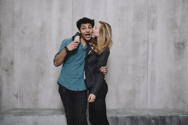 Couple in front of concrete wall, kissing - GCF000216