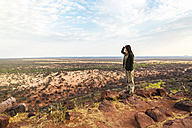 Namibia, woman overlooking the vast plains in the african savannah from a natural viewpoint - GEMF000925