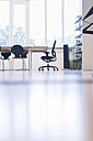 Table and chairs in empty conference room - RIBF000426
