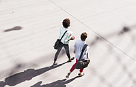 Back view of two walking businesswomen, seen from above - UUF008160