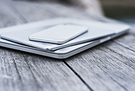 Stack of three mobile devices - UUF008187