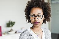 Portrait of businesswoman wearing glasses - UUF008208