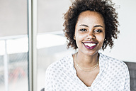 Portrait of smiling businesswoman - UUF008220
