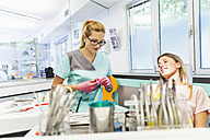 Dentist preparing tooth polish for patient - ZEDF000221