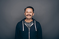 Portrait of smiling man with moustache - IPF000310