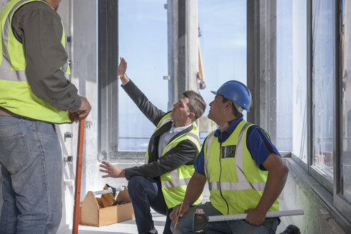 Architect and construction workers on construction site - ZEF009167