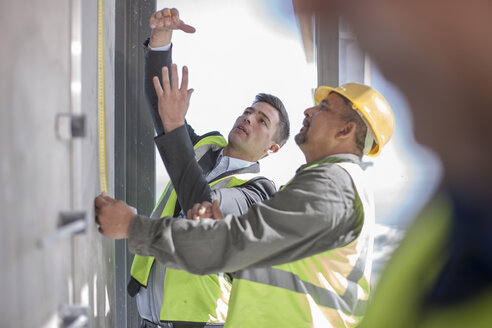 Architect and construction workers on construction site - ZEF009170