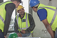 Architect and construction workers on construction site - ZEF009173
