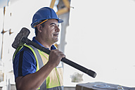 Confident construction worker with sledgehammer - ZEF009179