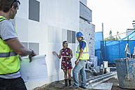 Construction worker and woman talking on construction site - ZEF009185
