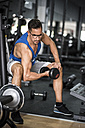 Man lifting dumbbell in gym - JASF000988