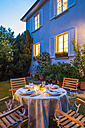 Laid table in garden in the evening - WDF003694
