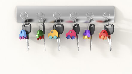 Car keys with different key ring hanging on key hook, electro car - AHUF000198