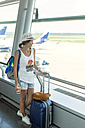 Vietnam, Ho Chi Minh city, young woman in airport - KNTF000431