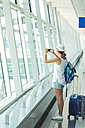 Vietnam, Ho Chi Minh city, young woman in airport - KNTF000434