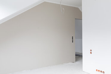 Empty grey wall at construction site of an apartment - SHKF000630