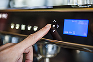 Finger pushing digital button on coffee machine - DIGF000794